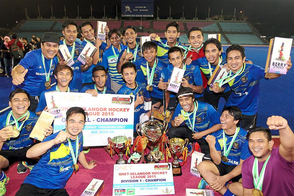 UiTM players celebrating with their challenge trophies and individual awards.