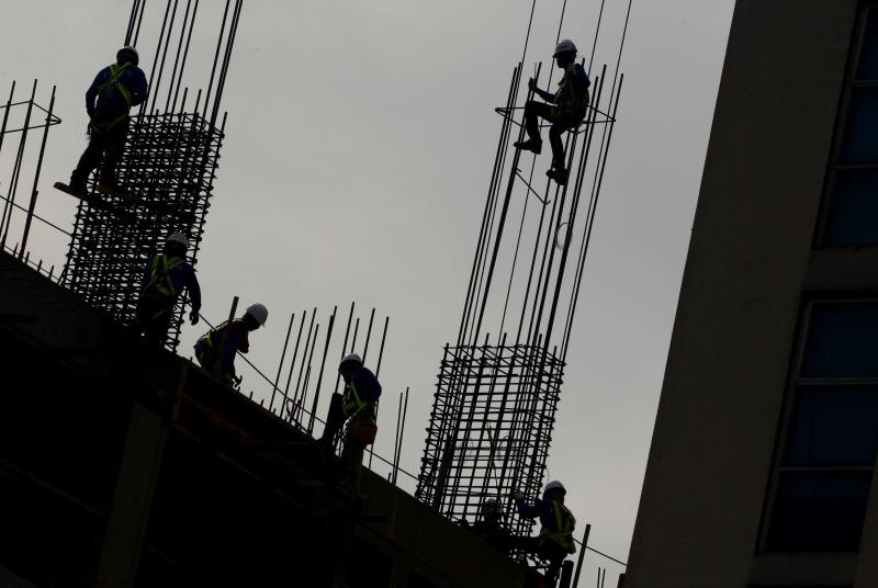 Worker check the steel reinforcement bars at a construction site in Manila on Jan 30, 2014. Business sentiment in Asia is up in Q1, according to the ThomsonReuters/INSEAD survey, with the Philippines being the most bullish - AFP Photo.