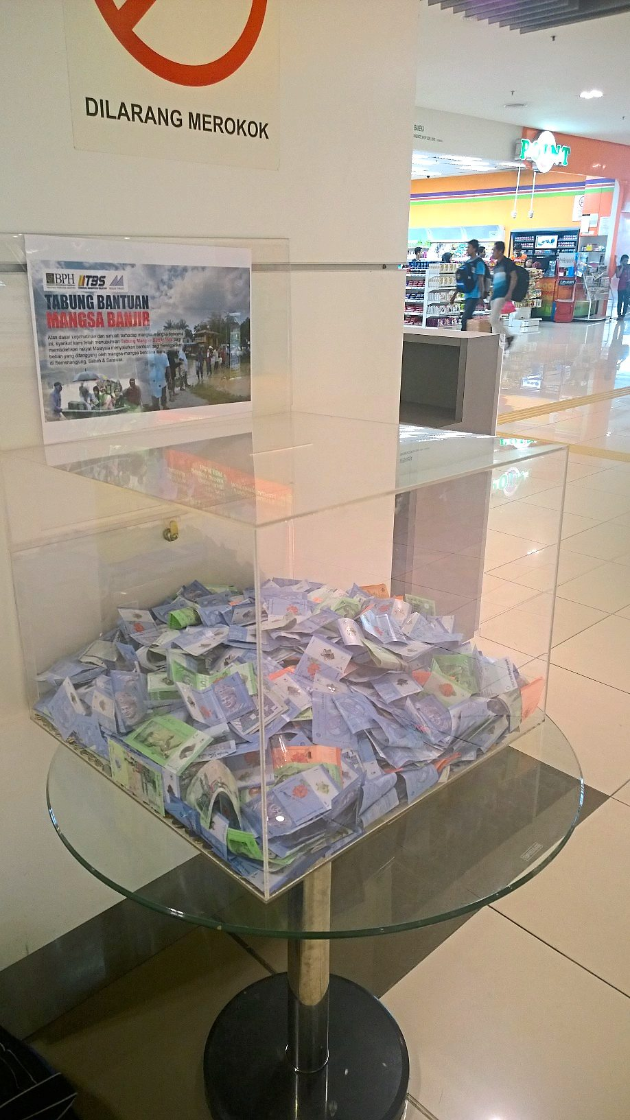 For victims: One of the two collection boxes in Terminal Bersepadu Selatan, located in the main hall area, that goes to helping disaster victims in Malaysia, the current goal being to help the flood victims in Kelantan.