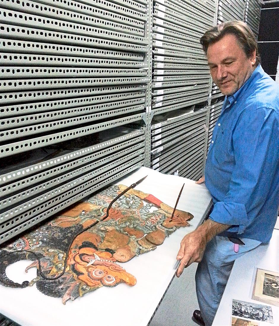Lin Liu Hsin Puppet Theatre Museum director Dr Robin Ruizendaal allows a rare glimpse into the storeroom with a collection of over 10,000 puppets - including wayang kulit and wayang golek.