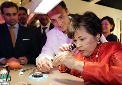 VIP treatment: Tourism Minister Datuk Seri Dr Ng Yen Yen taking a closer look at the intricacies of watch-making while Marclay pays close attention at the recent launch of The Art Of Time exhibition. Looking on is Valiram Group executive director Sharan Valiram.