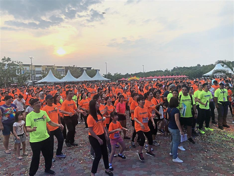 Participants warming up before the start of the run.