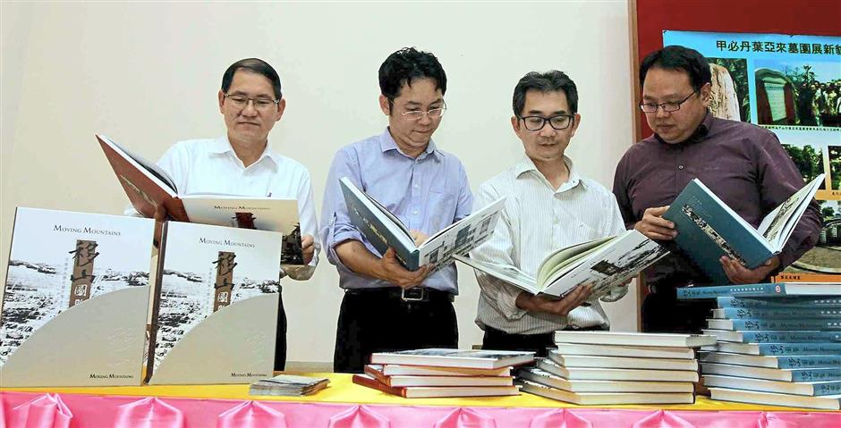 It looks good: The editor and authors of the trilogy (from left) Tang, Chiam, Dr Ser and Teoh checkig out copies of the books.