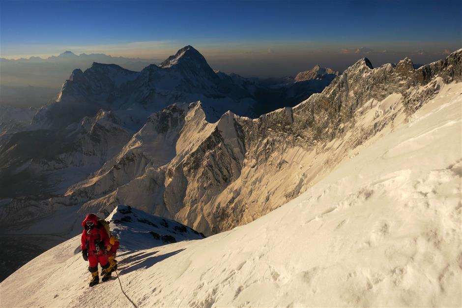 Climbers making their way towards the South Summit of Mount Everest.