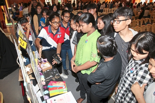 Convention participants checking out the various booths at the annual LEAD Convention in SMK Damansara Jaya. - ART CHEN/The Star