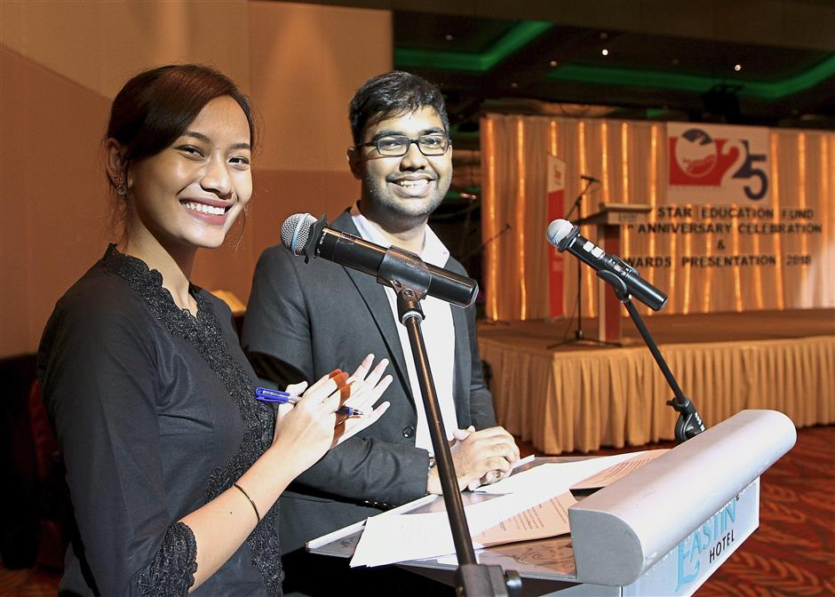 Emcees Saidatul Maisarah Faiesall (left) and Dinesh Jayabalan who are final year University of Nottingham Malaysia students, entertained the audience with their witty repartee.