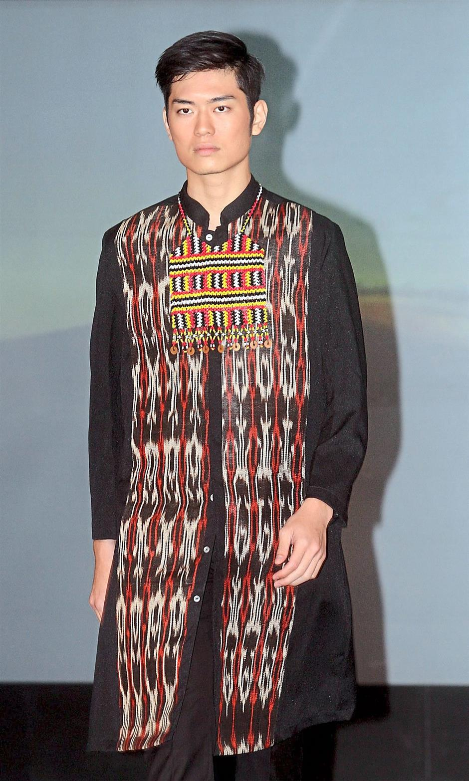 A long shirt by Alfonso Guino of the Philippines.The collection features the famous Filipino textile heritage of the tinalak or the banana fibre.