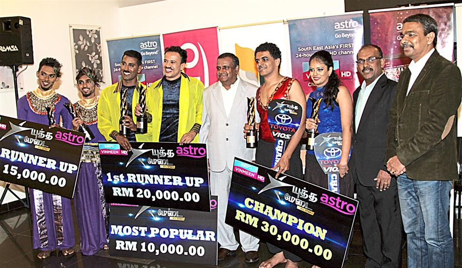 The top three winners with the organisers.