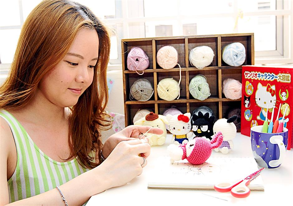 Creative mind: Lee working on her Sanrio amigurumi.