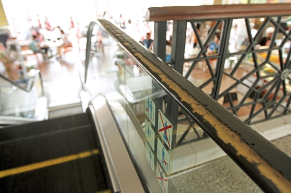 Facilities at the food court are showing signs of age, such as the escalators' handrails.
