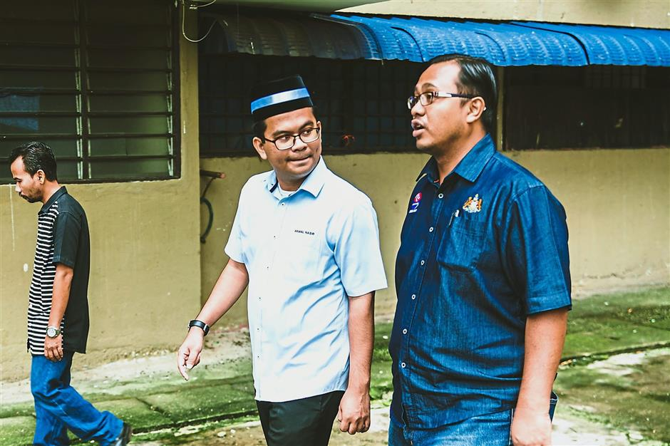 Caring leader: Akmal listening to the concerns of a resident.