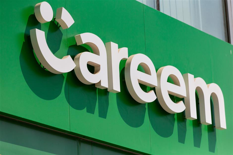 A Careem Networks FZ logo sits on the exterior of a driver support center at the ride-hailing company\'s headquarters in Dubai, United Arab Emirates, on Thursday, Oct. 4, 2018. Careem last month acquired Indian bus shuttle service app Commut as the Dubai-based ride-hailing firm expands into mass transport. Photographer: Christopher Pike/Bloomberg