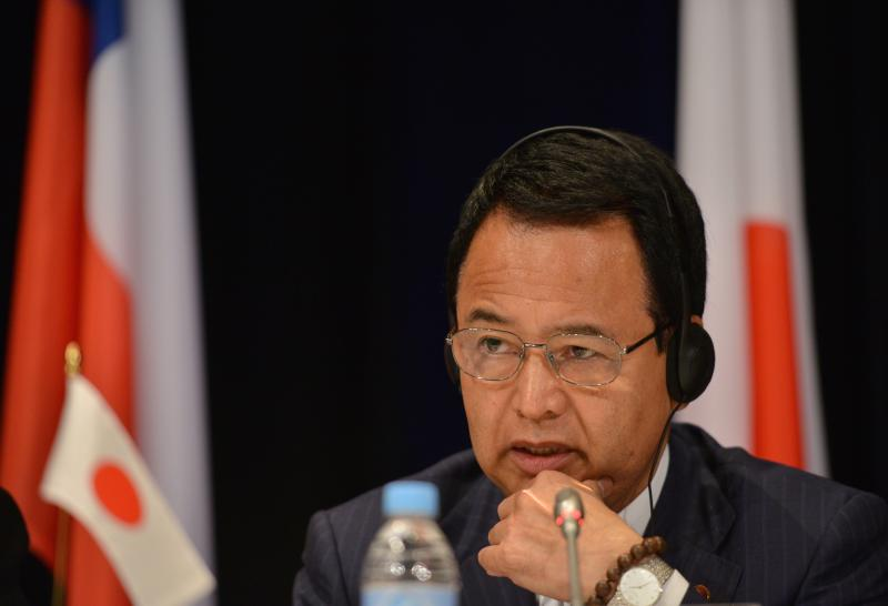 Japan\'s Economics Minister Akira Amari says the sales tax hike in Japan may be postponed but would eventually have to be implemented - AFP Photo.