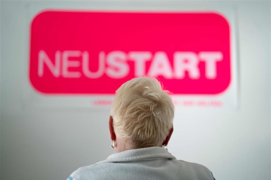 A woman waits for her counseling session at the Neustart organisation, after she posted a racist comment on Facebook, in Vienna, Austria on March 19, 2019. - When it comes to the problem of online hate speech, the culprits behind the keyboards and smartphones can take some surprising forms -- just take 74-year-old Viennese retiree Ms H. Angered by an article she read on the internet a year ago, the outwardly unassuming former midwife reacted with a Facebook outburst in which she said all immigrants should be poisoned on arrival in Austria. (Photo by JOE KLAMAR / AFP) / TO GO WITH AFP STORY BY Sophie MAKRIS