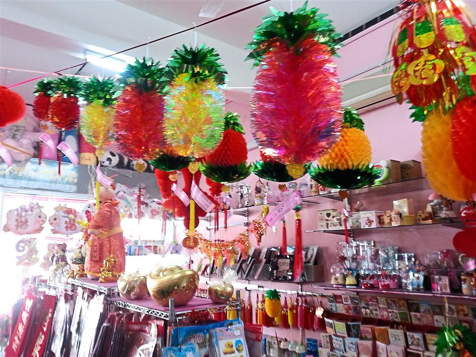 Popular choice: Laser pineapples which glow all day long are hot decorative items for this Chinese New Year.