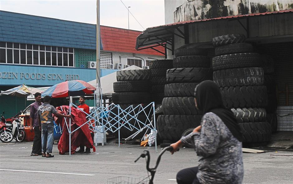 Car chop shops, selling spare parts including tyres (pictured) are a common sight, especially near the light industrial section in Taman Medan.