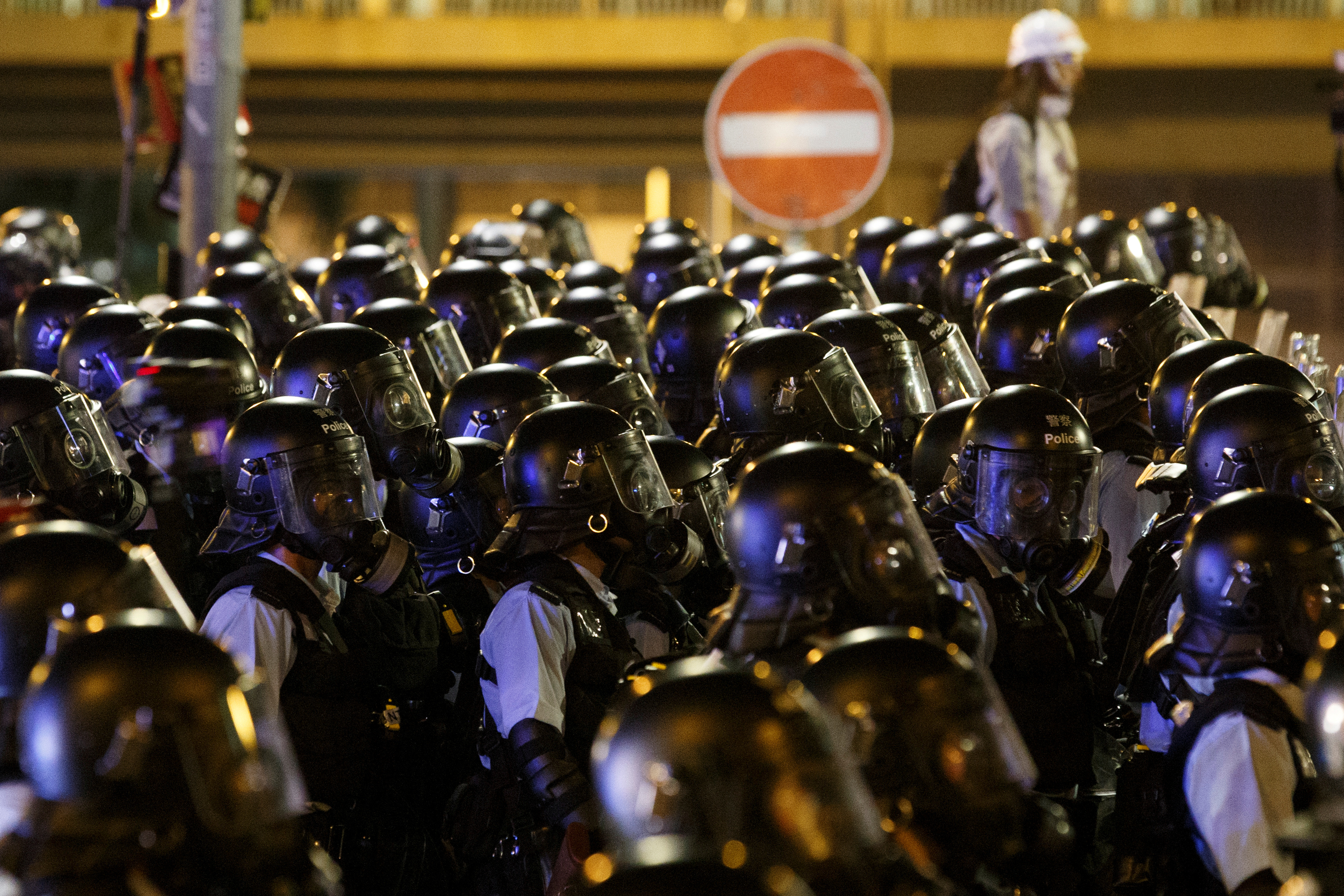 FILE PHOTO: Riot police clear the streets outside the Legislative Council building, after protesters stormed the building on the anniversary of Hong Kong's handover to China, in Hong Kong, China July 2, 2019. REUTERS/Thomas Peter/File Photo