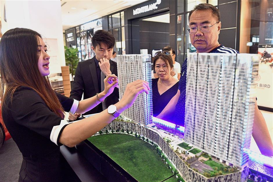 Visitors checking out Ewein Zenith Sdn Bhd's City of Dreams project in Gurney Plaza, Penang.