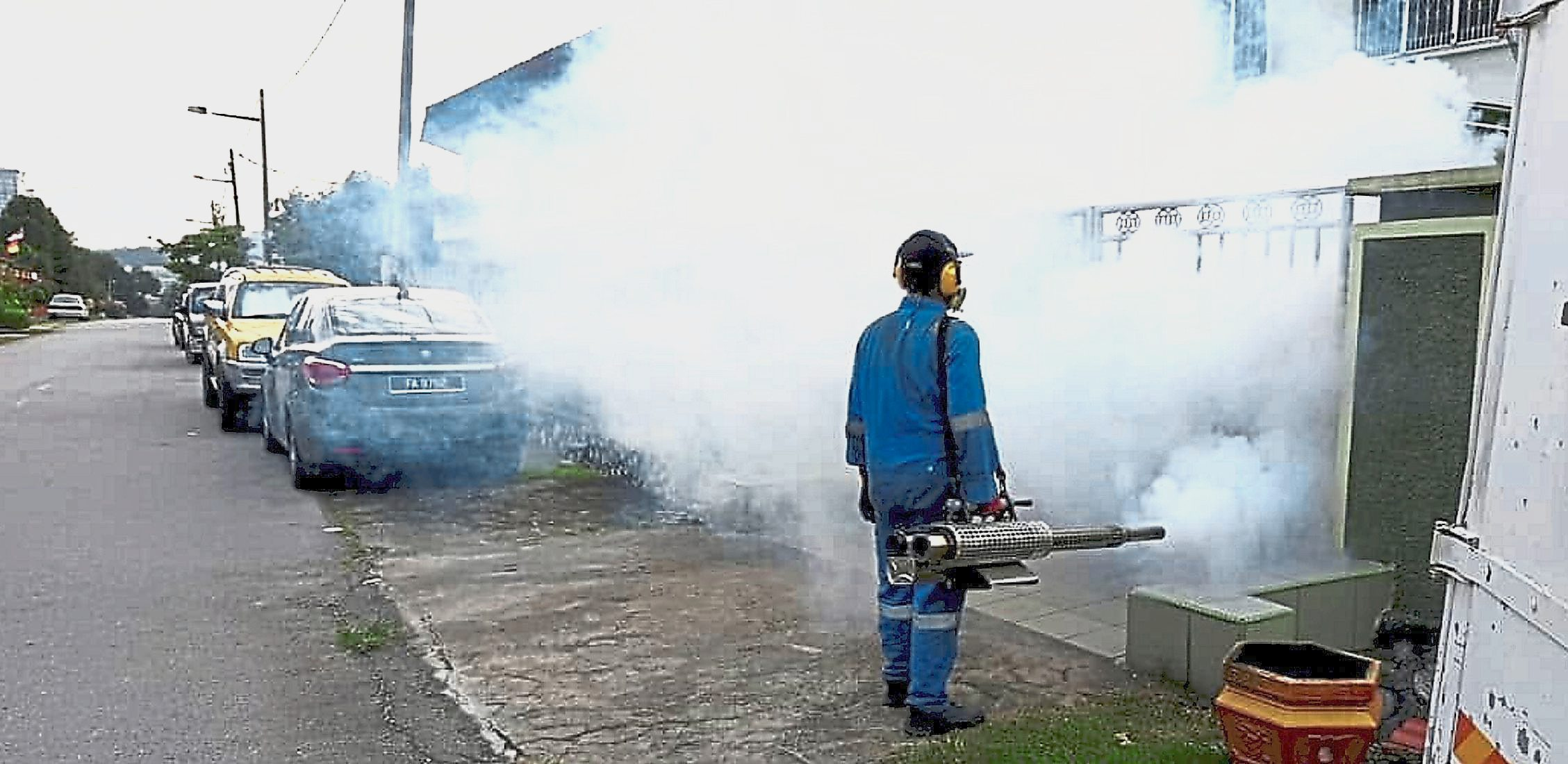 MPS Health Department vector unit worker  fogging a neighbourhood to prevent  the spread  of dengue.