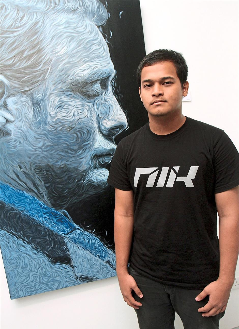Middle-child: Nik Mohd Shahfiz with 'Mikkelsen in Blue, a painting of Mads Mikkelsen, who plays Dr Hannibal Lecter, in TV's 'Hannibal'.