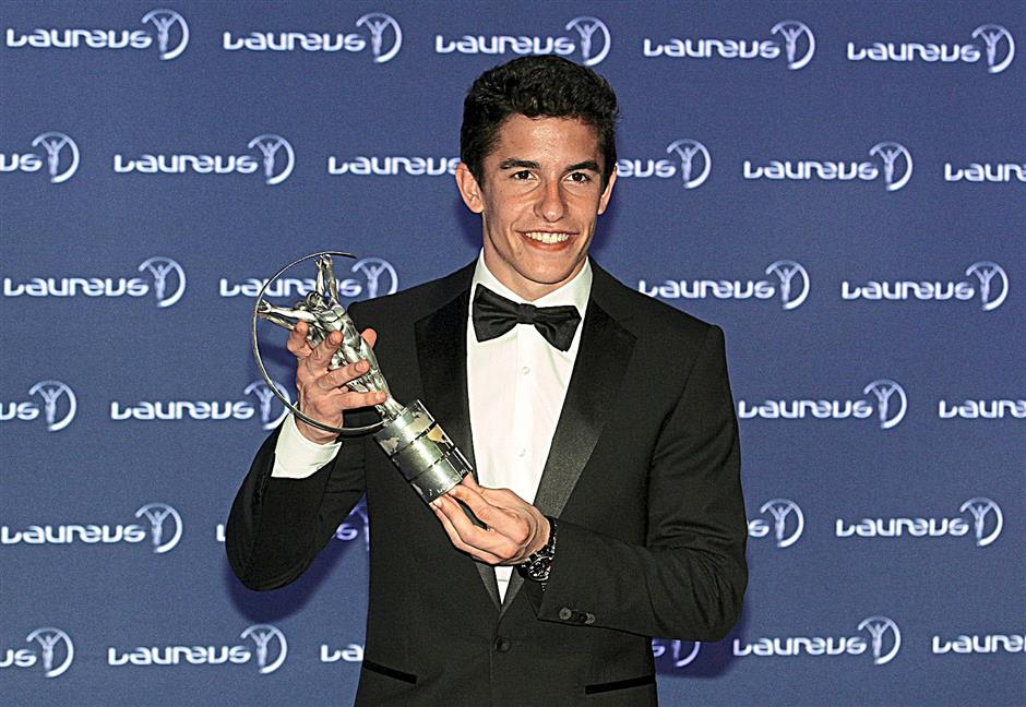 Motor cyclist Marc Marquez winner of the Laureus World Breakthrough of the Year award poses with their trophy at the winners photocall during the 2014 Laureus World Sports Awards at the Istana Budaya Theatre.