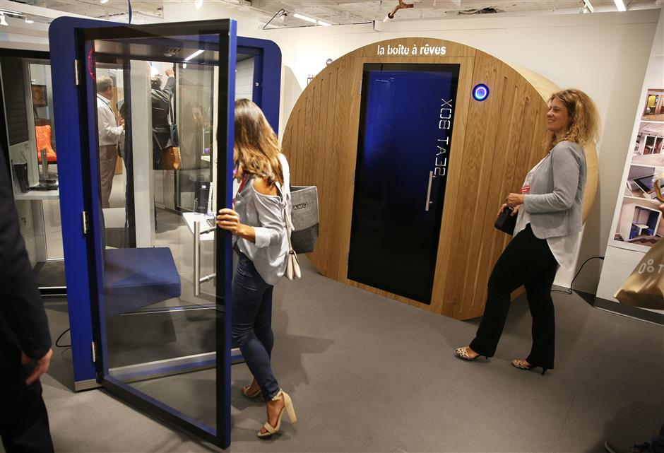 A number of manufacturers have come up with office 'sleep pods,' designed for a power nap or more elaborate relaxation techniques. Silence Business Solutions offers 'The Dream Box,' right, a 'recovery cocoon' with 12 light and sound atmospheres and a 15-minute program designed for power-napping, seen at NeoCon in the Merchandise Mart in Chicago, Ill. on Monday, June 11, 2018. (Terrence Antonio James/Chicago Tribune/TNS)