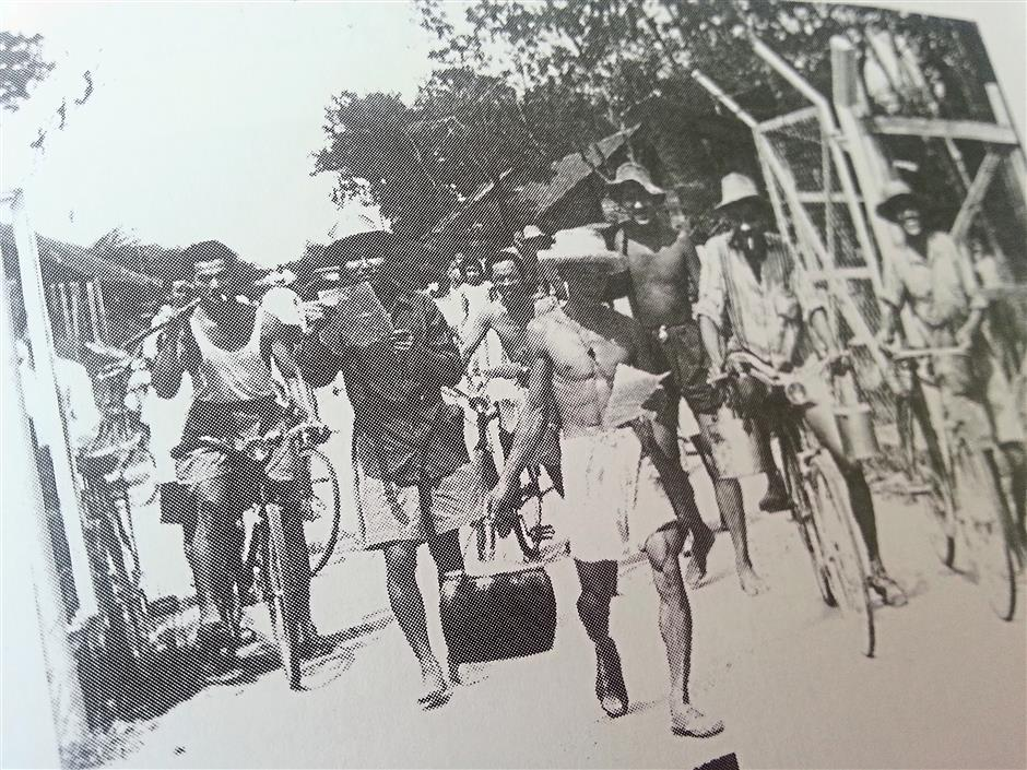 During the Emergency period, villagers stayed in fenced up new villages and their movements were restricted, and this picture shows them leaving their village, Pekan Gurney New Village, in the morning.