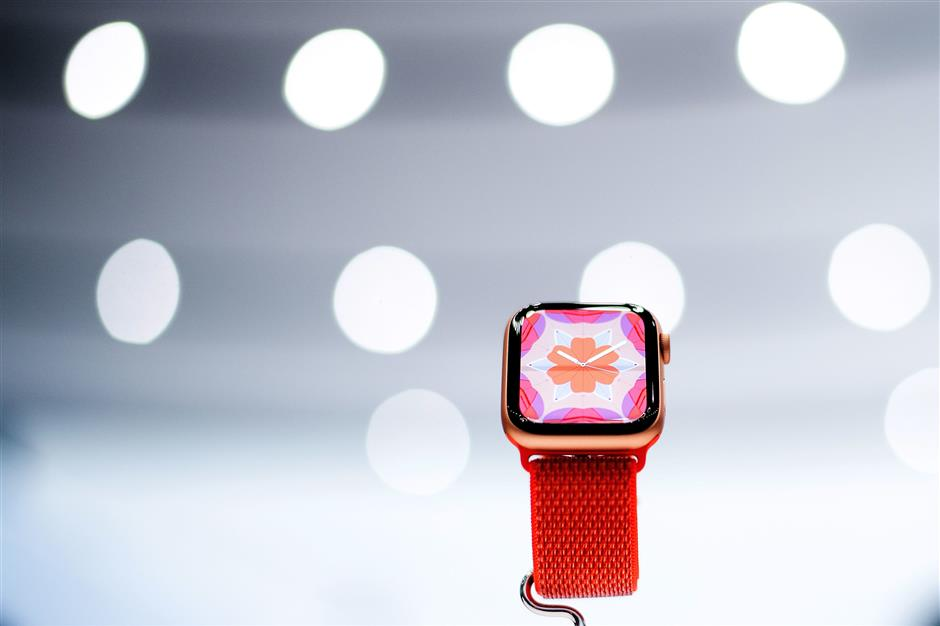 An Apple Watch Series 4 model rests on display during a launch event on September 12, 2018, in Cupertino, California. - New iPhones set to be unveiled Wednesday offer Apple a chance for fresh momentum in a sputtering smartphone market as the California tech giant moves into new products and services to diversify.Apple was expected to introduce three new iPhone models at its media event at its Cupertino campus, notably seeking to strengthen its position in the premium smartphone market a year after launching its $1,000 iPhone X. (Photo by NOAH BERGER / AFP)