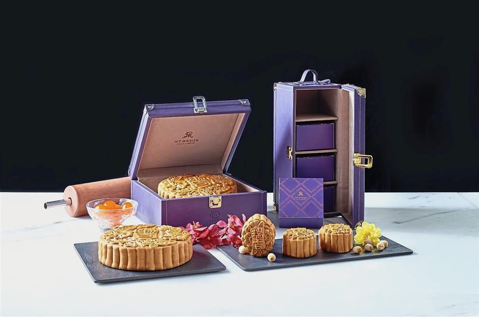 Mooncakes from St Regis Kuala Lumpur come encased in a mini purple faux-leather trunk ornamented with studs and silver locket, reflecting the hotel's heritage.