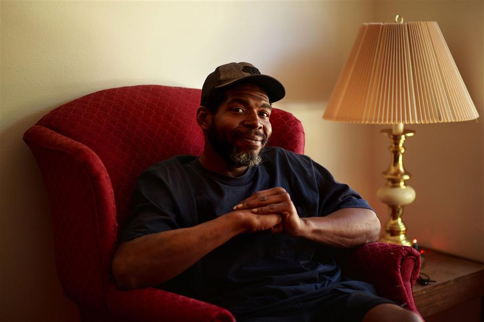 Michael McCollugh is photographed in his Shoreline apartment on May 2, 2018. 'I wouldn't wish being homeless on my worst enemy,' he said. (Erika Schultz/Seattle Times/TNS)