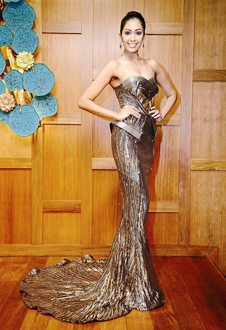 Simply divine: Beneett will be wearing the timeless bronze goddess-inspired evening gown by local designers Fiziwoo.