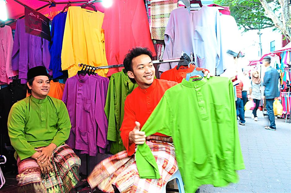 Cousins Safar (left) and Ibrahim are selling a line of baju Melayu under the Sri Tanjung name.