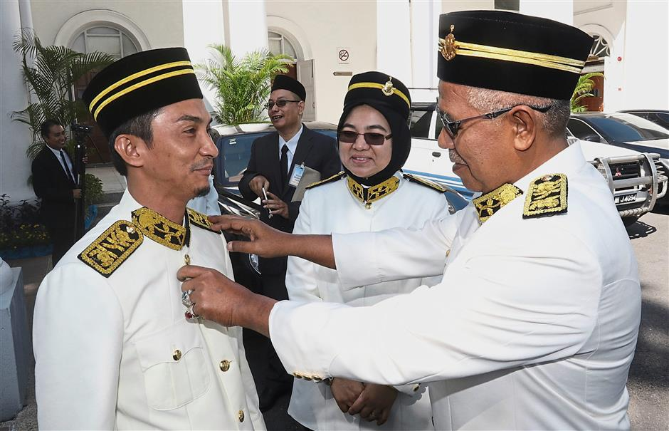 (From right) State Opposition Leader Muhamad Yusoff (BN-Sg Dua), Noor Hafizah (BN-Telok Air Tawar) and Mohd Yusni (PAS-Penaga) at the opening ceremony of the state assembly yesterday.
