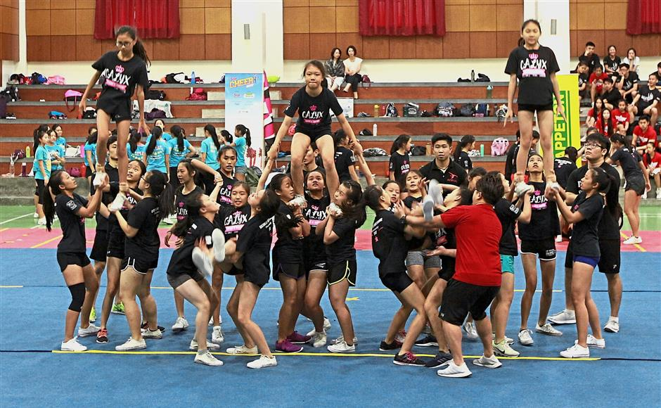 Carlyx, one of the teams that took part in the Cheer 2018 clinic session at Sri Kuala Lumpur, Subang Jaya, working together to perfect their routine. — Photos: NORAFIFI EHSAN/The Star