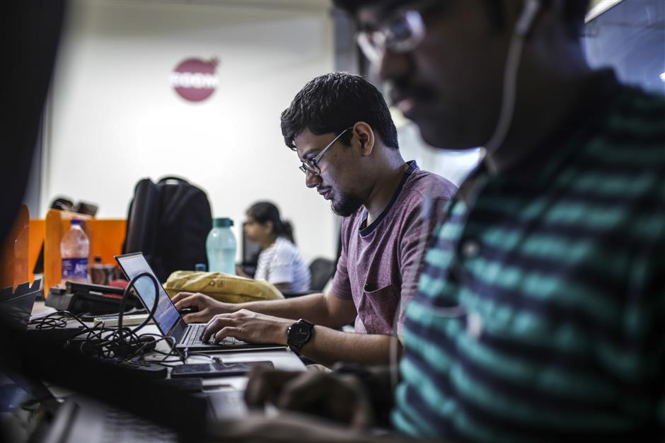Employees work at the Boom Live office in Mumbai, India, on Friday, March 28, 2019. Boom is one of seven tiny fact-checking firms at the heart of Facebook Inc.'s efforts to rebuild some of its credibility during India's elections. Photographer: Dhiraj Singh/Bloomberg