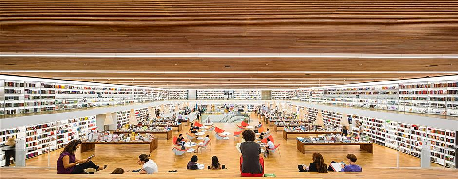 Retail: Cultura Bookstore, Sao Paulo, Brazil u2013 Designed by studio mk27, this bookstore comes across as spatially grand yet modest in design. The store incorporates socialising, reading, relaxing, events, and purchasing into one space, reflecting a trendy, up-to-date 21st century bookshop. The top floor houses the main store area, which is a large expanse lined with bookshelves that features an open space with lounge chairs for customers.