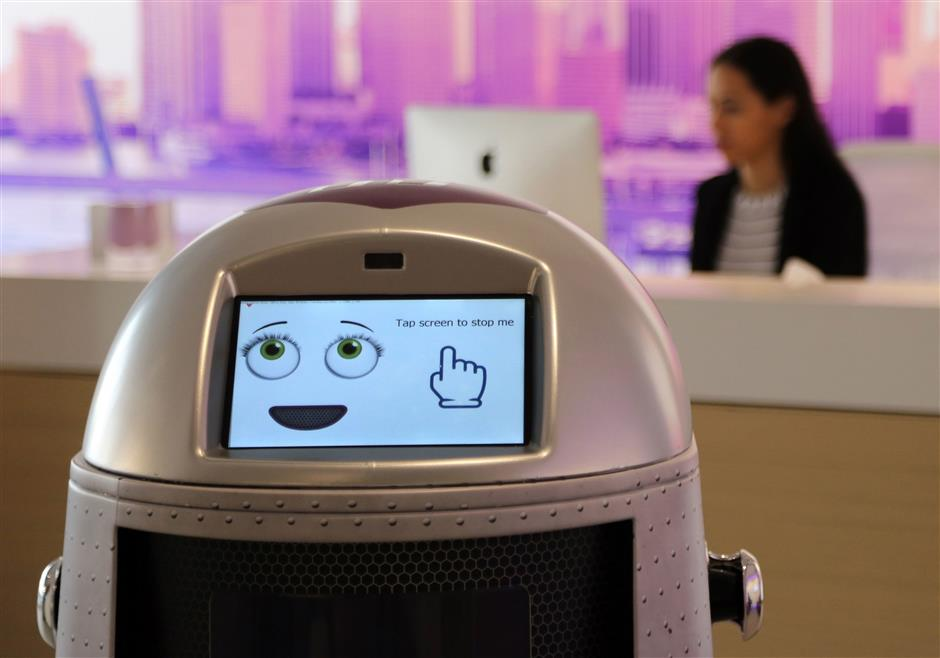 Yotelpad Miami has introduced its robotic concierge concept that will roam through its property, giving directions, serving snacks and beverages, use the elevator, and performing bellhop duties at their Yotelpad Miami location. The robots have several different greetings and verbal responses and features a touch screen with various facial expressions. The device was available for review inside the Yotelpad Miami sales gallery in downtown Miami, Fla. on Monday, Aug. 27, 2018. (Carl Juste/Miami Herald/TNS)