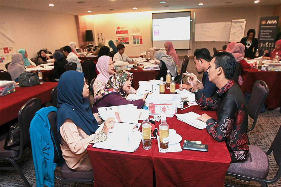 Genosis training for teachers, school improvement specialist coaches, district education officers and Institute of Teacher Education Malaysia lecturers in Putrajaya.