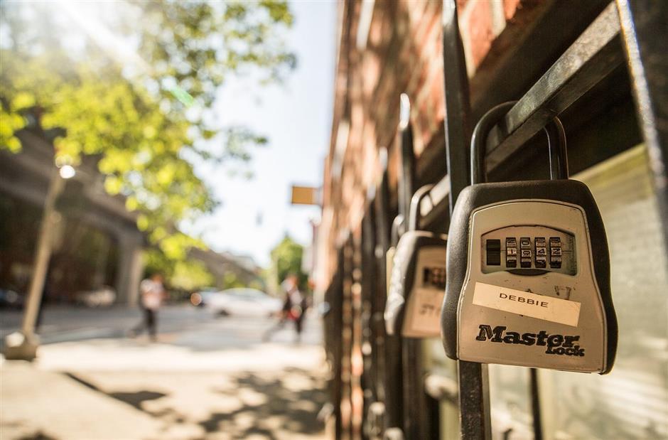 Airbnb lockboxes outside 2132 Fifth Avenue in Seattleu2019s Belltown neighborhood on Monday, July 8, 2019. (Rebekah Welch/The Seattle Times/TNS)