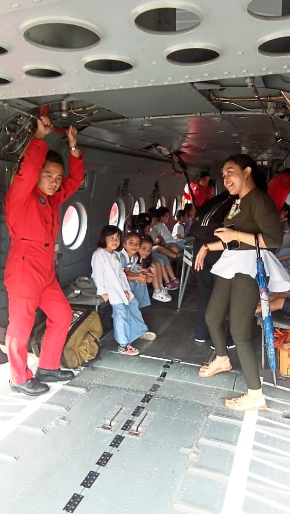 The youngsters experiencing what it is like to board a Fire and Rescue Department plane.