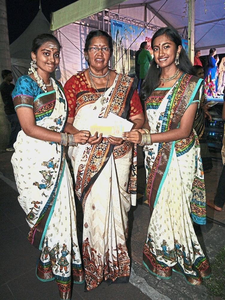 (From left) Rasshwini, Thanaletchumi and Pritikaa won the 'Best Traditional Dress' award.