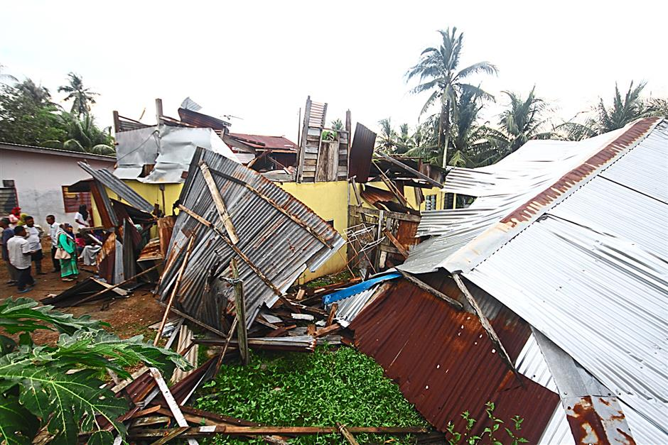 Scene of disaster: One of the houses in Kampung Sungai Nonang badly damaged after it was hit by a mini tornado.   - OH CHIN ENG / The Star