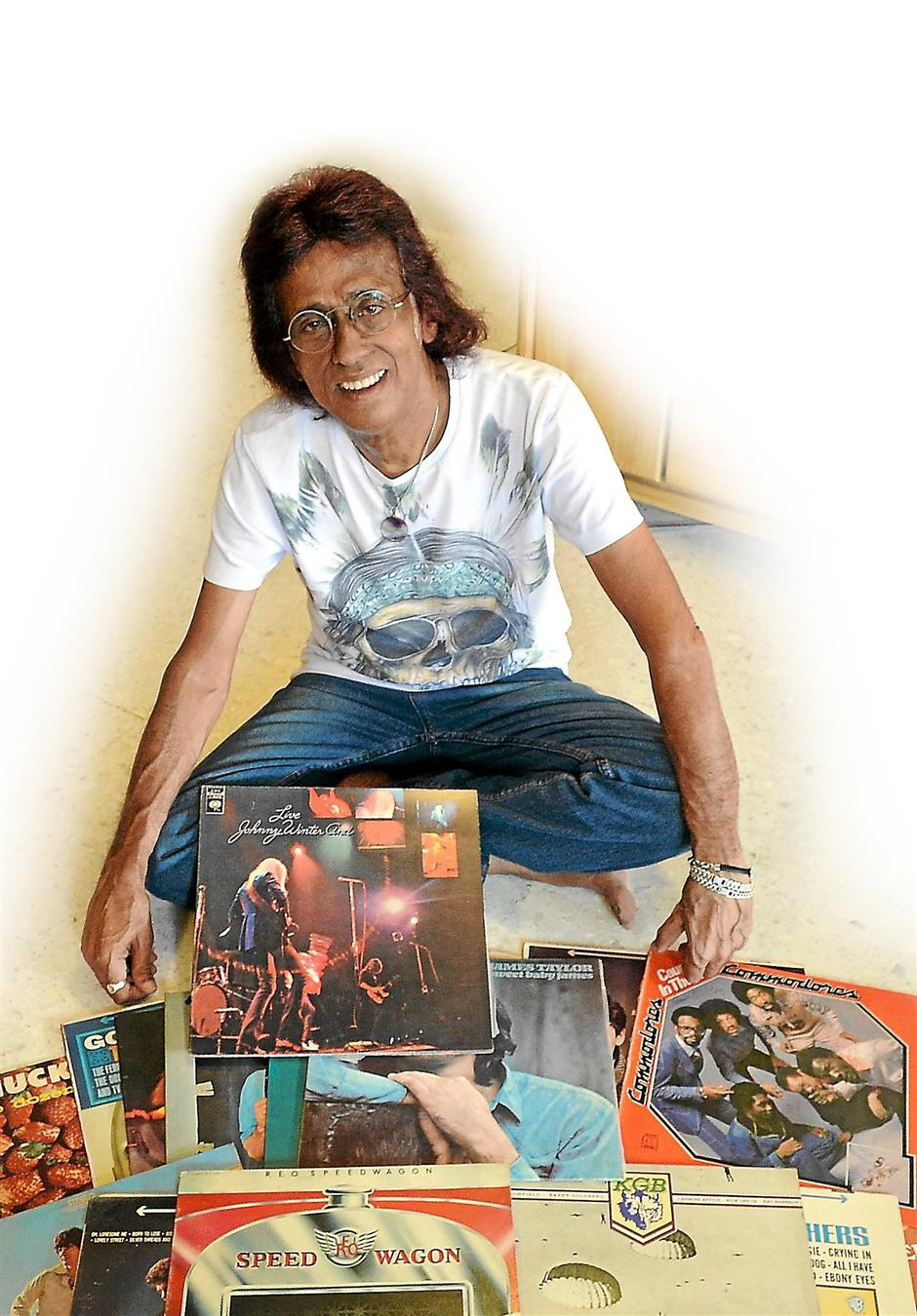 Richard Joseph with his collection of vinyl records.