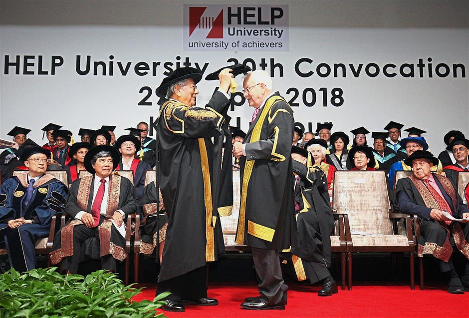 Leong (left) presents the honorary degree to Prof Blake.