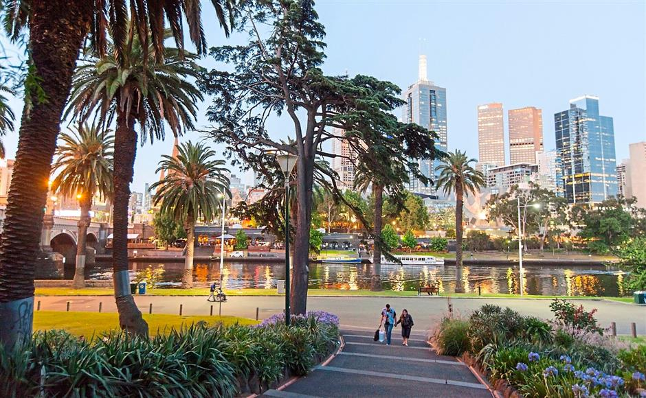 Scenic: A view of Yarra River at dusk with the city centre in the background from Alexandra Gardens, which is adjacent to Southbank.