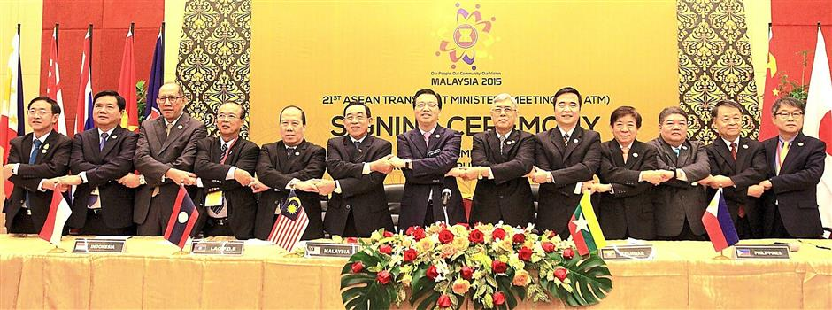 In agreement: Liow (centre) posing for a group picture after the signing ceremony for the Ninth Package of Commitments on Air Transport Services.