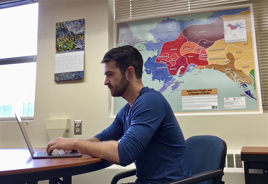 In this Aug. 8, 2018, photo provided by Ashley Holloway, Myles Creed uses the new Inupiat Eskimo language option now available for Facebook bookmarks, action buttons and other interface functions in Fairbanks, Alaska. Alaskans made the option a reality through the social media giant's community translation tool. (AP Photo/Ashley Holloway)