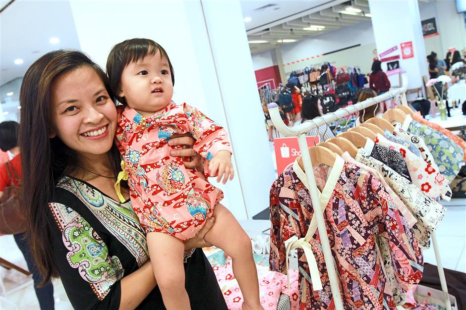 Wong Sue Leen showing off the cute kimono rompers at her booth at Markets,Jaya one.