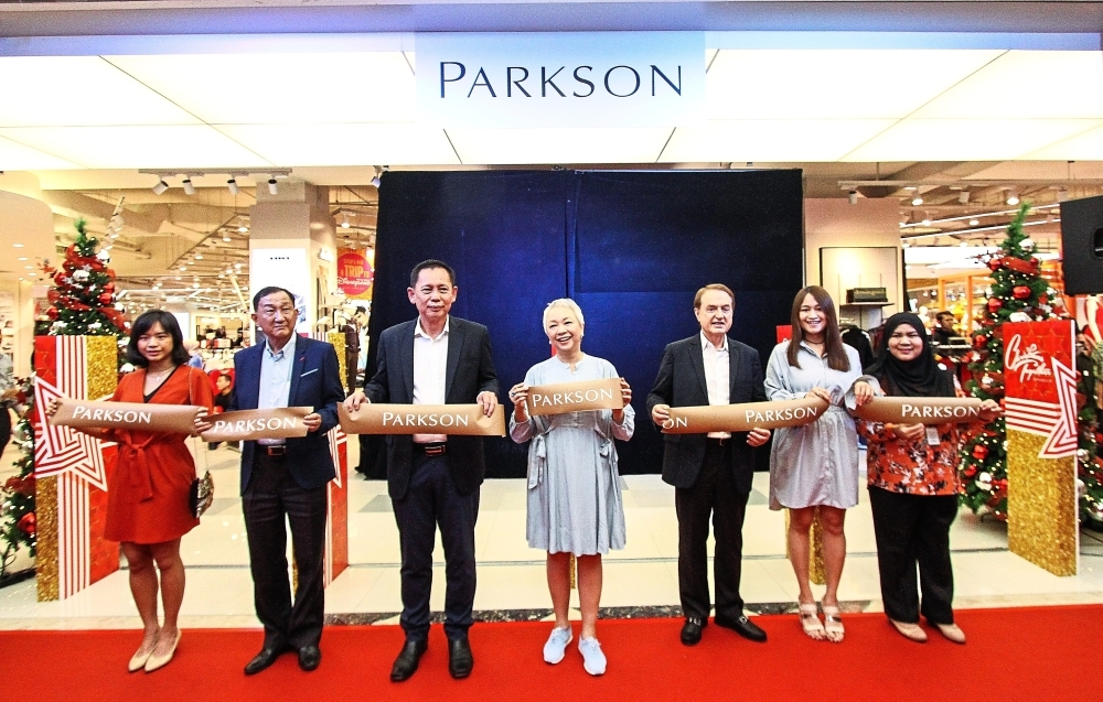 (From left) Parkson Holdings Bhd executive director Natalie Cheng, Law, Chan, Chelsia, Remsen, Parkson Retail Asia executive director Vivien Cheng and Parkson senior store manager Halimatul Sadiah at the ribbon-cutting ceremony to launch the new look.