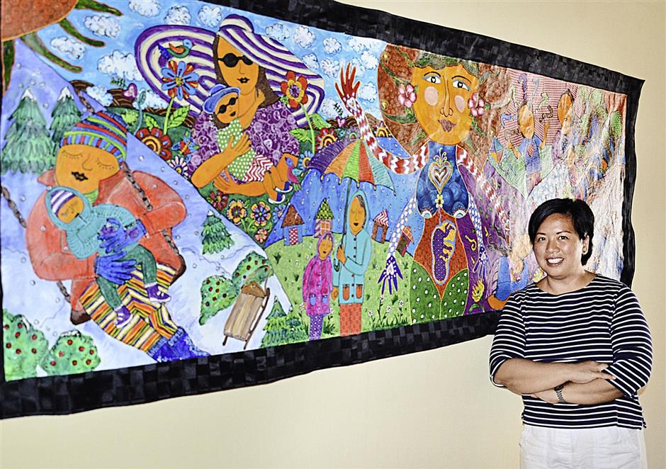 Artist Paulina Constancia posing with her piece,